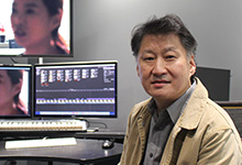 Photo of David Chung in the editing room